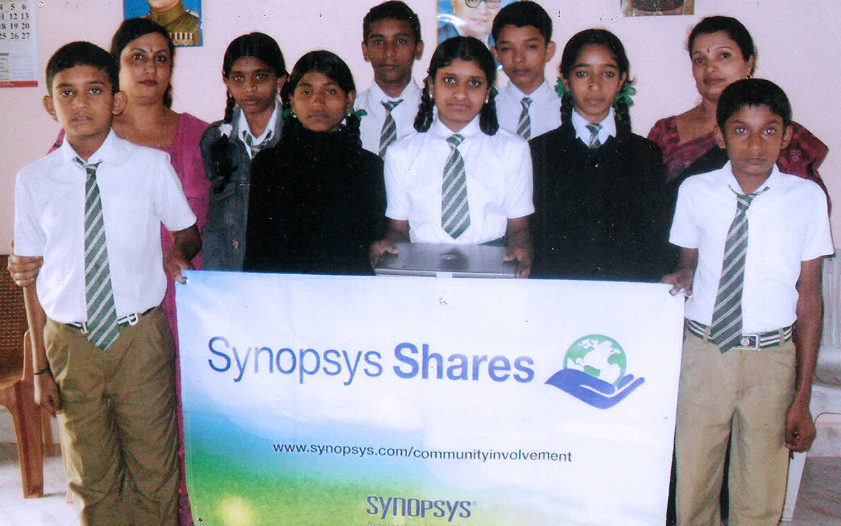 Students appreciate the gesture of corporate donors who provided them with laptop computers. At MCSS High School, Ponnappasanthe.