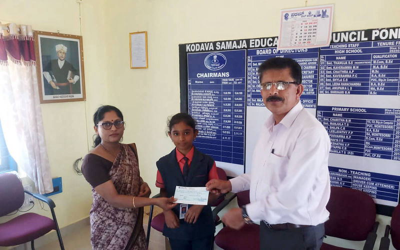 Handing over assistance cheque to beneficiary by Secretary of KESST.